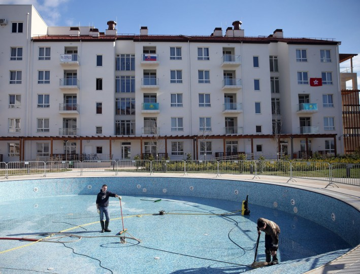 Workers clean a pool inside Olympic Village at the Winter Olympics in Sochi, Russia. (Brian Cassella/Chicago Tribune/MCT)