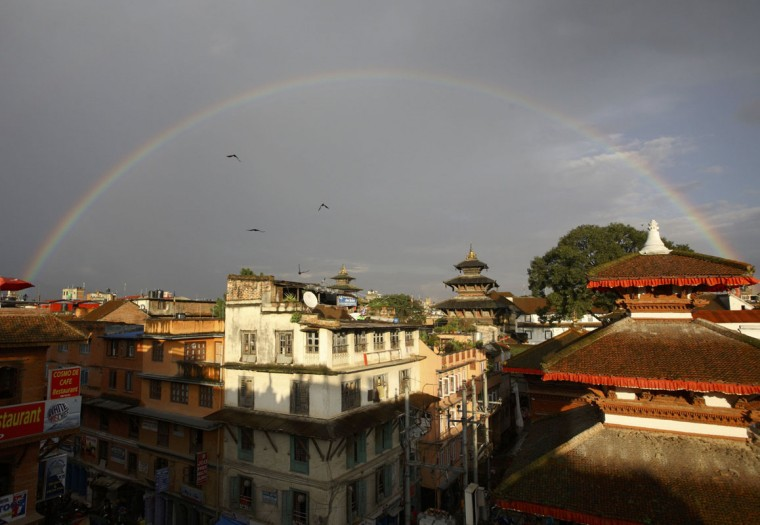 A rainbow is seen after rainfall with the backdrop of Bashantapur Durbar Square in Kathmandu Sept. 29, 2011. (Reuters)