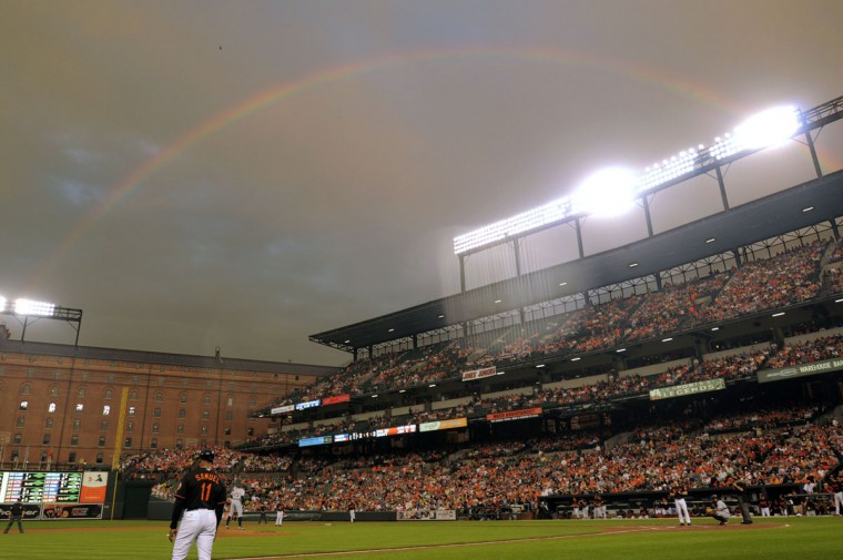 Clouds and a light rainbow hang over the ballpark as Baltimore Orioles designated hitter Luke Scott stands at the plate just before he hit a grand slam against the Detroit Tigers on the night of Baltimore Orioles catcher Matt Wieters' debut in front of 42,704 paid fans at Oriole Park at Camden Yards May 29, 2009. (Karl Merton Ferron / Baltimore Sun Staff)
