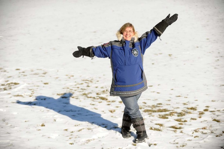 Gilman 3rd grade teacher Jen Reiter poses in her traditional Eskimo designed jacket and other official apparel for the Iditarod race, in a snowy field at the school on Thursday, Jan 30. Reiter is this year's national Teacher on the Trail for the annual Iditarod dog sled race in Alaska which begins March 1. || Baltimore, Md. 1/30/14 Staff Photo by Brian Krista
