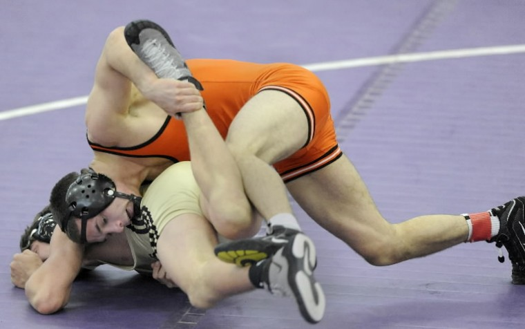 McDonogh's Toby Hague, top, wrestles John Carroll's Austin Ross in the 152-pound final at the MIAA wrestling championship. (Steve Ruark/BSMG)