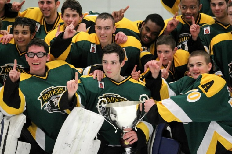 Atholton poses for a team photo while they celebrate winning the annual County Cup ice hockey game over Glenelg. (Jen Rynda/BSMG)