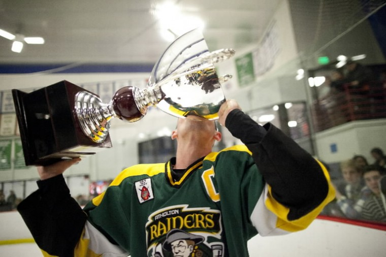 Atholton's Evan Davis holds the County Cup up and kisses it after winning the annual County Cup ice hockey game over Glenelg. (Jen Rynda/BSMG)