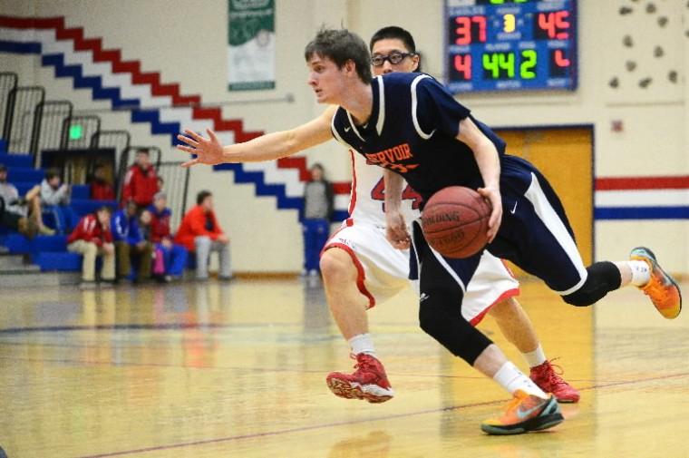 Reservoir's Kyle Reilly, front, moves the ball past Centennial's Min An. (Matt Hazlett/BSMG)