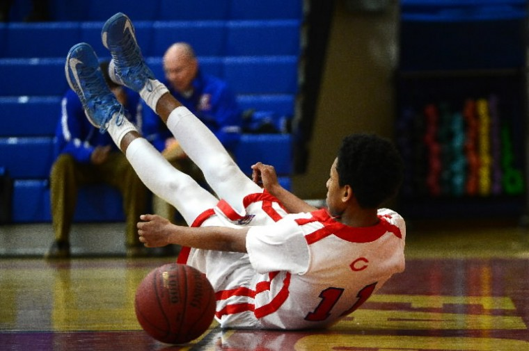 Centennial's Isaiah White is pushed out of bounds during a game against Reservoir. (Matt Hazlett/BSMG)