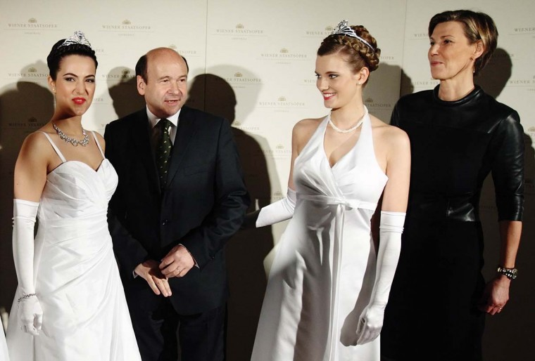 Debutants dressed for the Opera Ball pose with ball organizer Desiree Treichl-Stuergkh (R) and opera director Dominique Meyer during the presentation of their tiaras in Vienna January 28, 2014. The traditional Vienna Opera Ball takes place on February 27. || Credit: Heinz-Peter Bader - Reuters