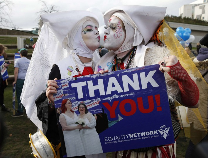 Supporters attend a symbolic same-sex marriage outside the Scottish Parliament in Edinburgh, Scotland February 4, 2014. Scotland voted on Tuesday to allow same-sex marriages, becoming the 17th country to give the green light to gay marriages and paving the way for the first wedding ceremonies later this year. (Russell Cheyne/Reuters)
