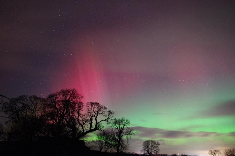 The aurora borealis is seen in the night sky over Cumbria in northwest England in this picture provided by Jonathan Cooper February 27, 2014. (REUTERS/Jonathan Cooper/Handout via Reuters)