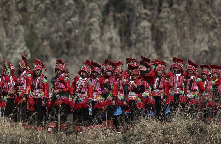 Ethnic Yi women are seen on their way to a dragon worship ceremony in Shiping county, Yunnan province, February 4, 2014. The dragon worship ceremony is held every 12 years in Shiping to pray for good fortune and harvest. (Wong Campion/Reuters)