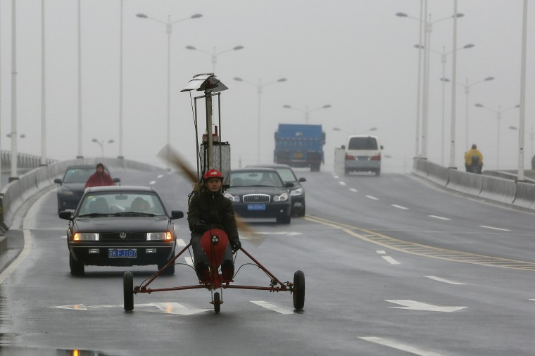 Luo Jinsha drives his self-made aircraft during a test flight on the outskirts of Shanghai, February 26, 2014. Luo, 28, a migrant worker living in Shanghai, spent around eight months and 40,000 yuan ($6,529) to build the plane to fulfil his dream to fly. Despite failing during the first test flight, Luo said he will not give up hope on improving his plane so as to eventually fly it successfully. The aircraft was able to move quickly on the ground but could not take to the air on second attempt. (REUTERS/Aly Song)