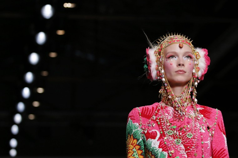 A model presents a creation by Indian designer Manish Arora as part of his Fall/Winter 2014-2015 women's ready-to-wear collection during Paris Fashion Week. (Stephane Mahe/Reuters)