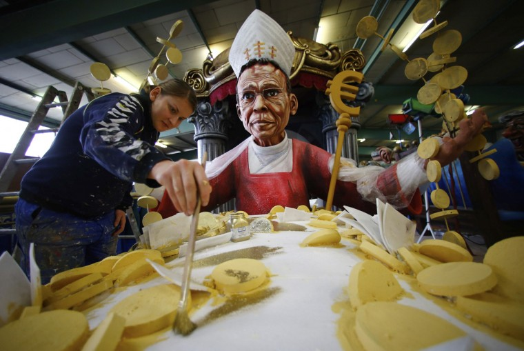 "A carnival enthusiast works on a papier mache figure for a carnival float depicting Bishop Franz-Peter Tebartz-van Elst of Limburg, in preparations for the upcoming Rose Monday carnival parade in Mainz February 25, 2014. Tebartz-van Elst reaped stiff criticism from German Catholics and the title ""luxury bishop"" in the media after it was revealed he spent at least 30 million euros ($40.69 million) on a new residence complex. (Ralph Orlowskk/Reuters)"