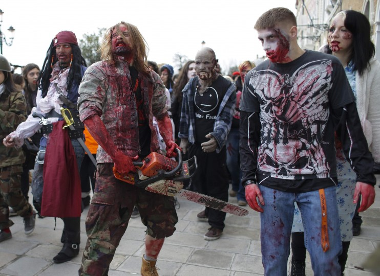 "People dressed as zombies take part in a ""Zombie Walk"", part of the Venetian Carnival, in Venice February 15, 2014. REUTERS/Max Rossi"