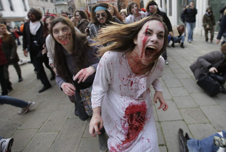 """People dressed as zombies take part in a """"Zombie Walk"""", part of the Venetian Carnival, in Venice February 15, 2014. REUTERS/Max Rossi"""