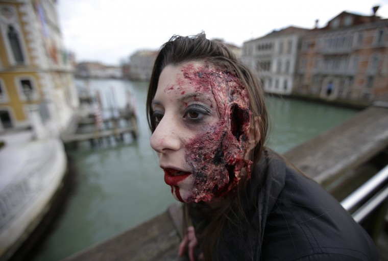 "A participant is pictured during a ""Zombie Walk"", part of the Venetian Carnival, in Venice February 15, 2014. REUTERS/Max Rossi"