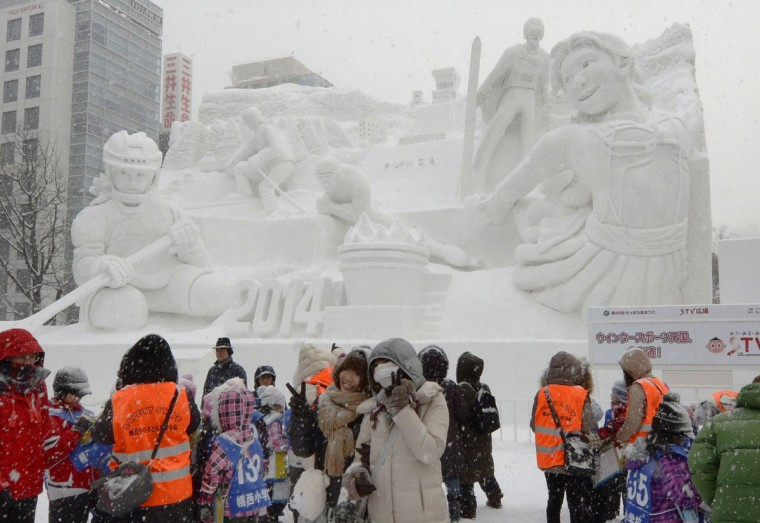 Visitors pose for photos in front of a snow sculpture made in the theme of the Sochi Winter Olympics at Sapporo Snow Festival in Sapporo, on Japan's northern island of Hokkaido. The snow festival is one of the biggest winter events in Japan, which runs from February 5 to February 11. (Kyodo/Reuters)