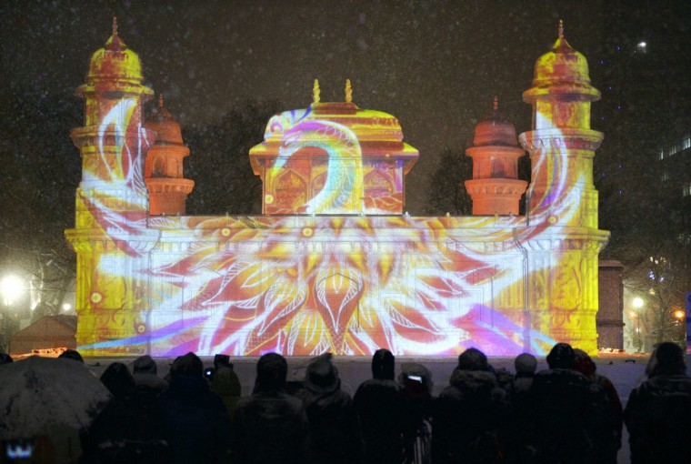 Computer graphic images, using projection-mapping technology, are beamed onto a snow sculpture a day before the Sapporo Snow Festival starts in Sapporo, on Japan's northern island of Hokkaido, in this photo taken by Kyodo. The snow festival is one of the biggest winter events in Japan, which runs from February 5 to February 11. (Kyodo/Reuters)
