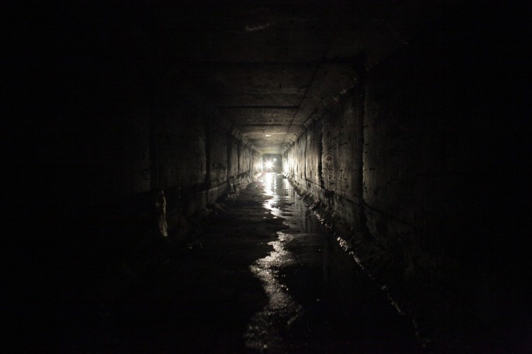 "Journalists use flashlights while walking through the city's drainage system towards a tunnel that comes out of one of the houses of Joaquin ""Chapo"" Guzman in Culiacan. Guzman, who rose from humble origins to become one of the most powerful drug barons in history, was captured on Saturday in a raid in the beachside resort and fishing center of Mazatlan, 125 miles southeast of Culiacan, just days after escaping from the clutches of Mexican troops through a tunnel and sewers. (Daniel Becerril/Reuters)"