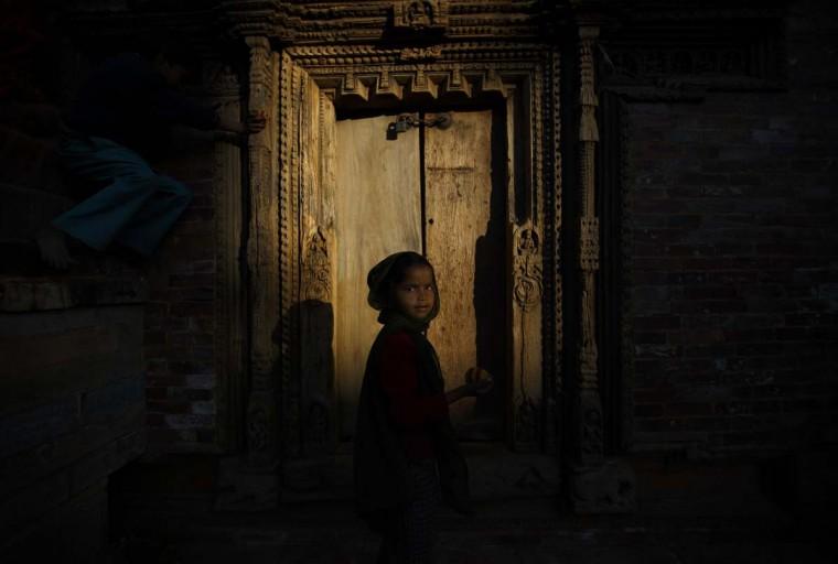 Evening light illuminates a girl playing at the Patan Durbar Square in Lalitpur February 3, 2014. (Navesh Chitrakar/Reuters)