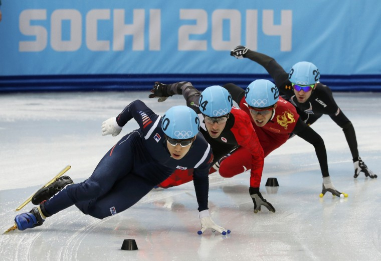 South Korea's Lee Han-bin (L) leads in front of Canada's Michael Gilday (second left) during the men's 1,500-meters short track speedskating competition at the 2014 Sochi Winter Olympics, February 10, 2014. (Alexander Demianchuk/Reuters)