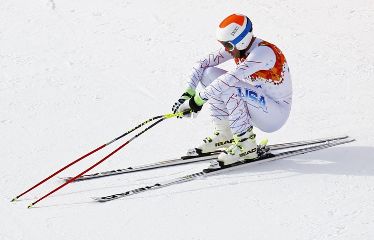 Bode Miller of the U.S. squats after his men's alpine skiing downhill race during the 2014 Sochi Winter Olympics at the Rosa Khutor Alpine Center, February 9, 2014. (Kai Pfaffenbach/Reuters)
