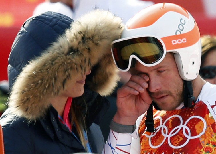 Third-placed Bode Miller (right) of the U.S. cries after the men's alpine skiing Super-G competition during the 2014 Sochi Winter Olympics at the Rosa Khutor Alpine Center February 16, 2014. (Mike Segar/Reuters)