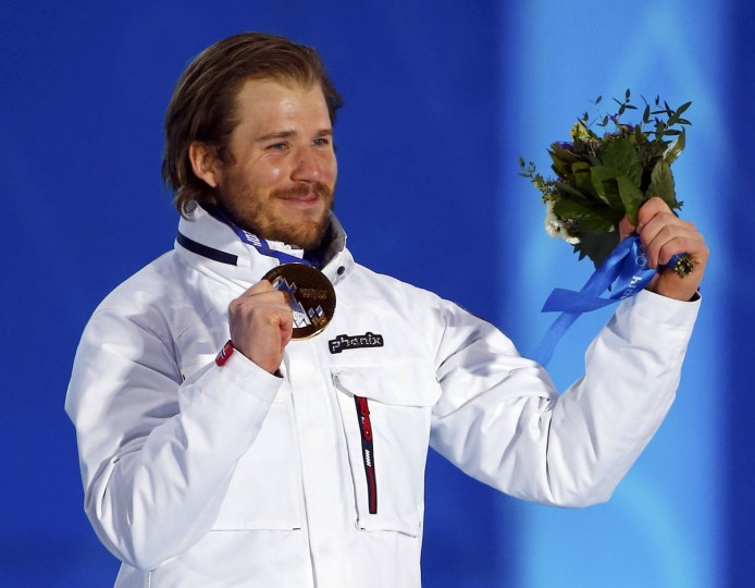 Gold medallist Norway's Kjetil Jansrud poses during the victory ceremony for the men's alpine skiing Super-G competition at the 2014 Sochi Winter Olympics February 16, 2014. (Shamil Zhumatov/Reuters)