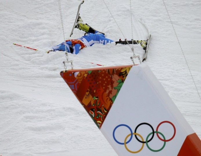 Italy's Patrick Thaler reacts in the snow after crashing in the first run of the men's alpine skiing slalom event during the 2014 Sochi Winter Olympics at the Rosa Khutor Alpine Center February 22, 2014. (REUTERS/Mike Segar)