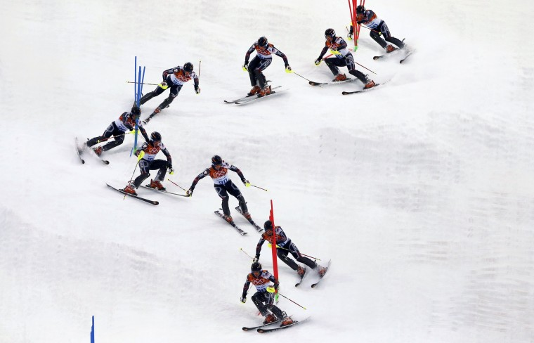 Latvia's Martins Onskulis speeds down the course during the first run of the men's alpine skiing slalom event at the 2014 Sochi Winter Olympics at the Rosa Khutor Alpine Center February 22, 2014. (REUTERS/Mike Segar)