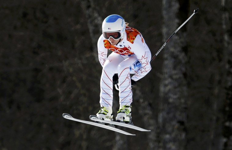 Julia Mancuso of the U.S. goes airborne during the downhill run of the women's alpine skiing super-combined event at the 2014 Sochi Winter Olympics, February 10, 2014. (Stefano Rellandini/Reuters)