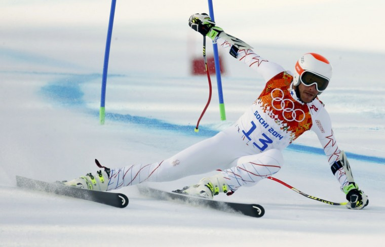 Bode Miller of the U.S. clears a gate during the men's alpine skiing Super-G competition at the 2014 Sochi Winter Olympics at the Rosa Khutor Alpine Center, February 16, 2014. (Ruben Sprich/Reuters)