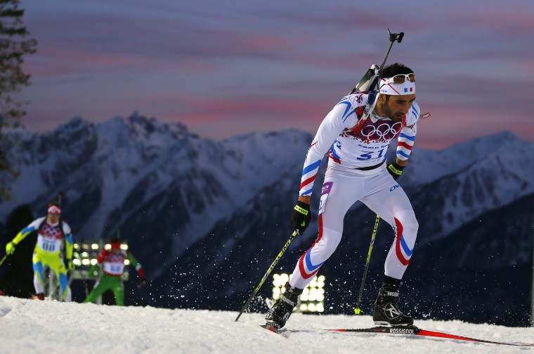 France's Martin Fourcade skis during the men's biathlon 20 km individual event at the Sochi 2014 Winter Olympics in Rosa Khutor February 13, 2014. REUTERS/Dominic Ebenbichler