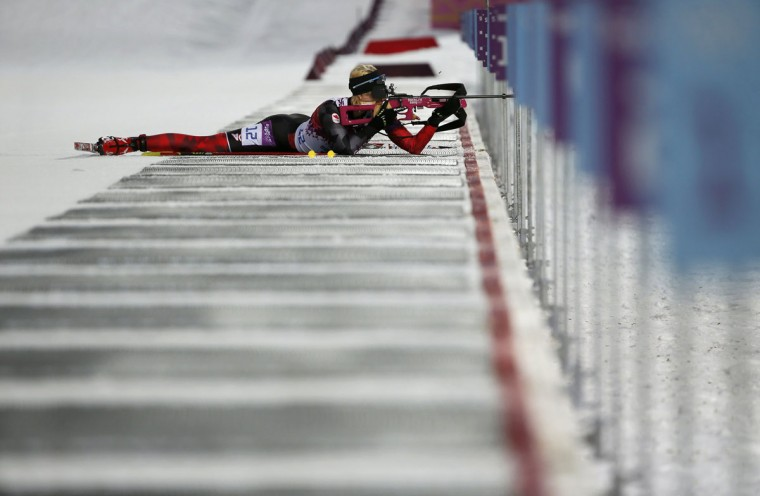 Canada's Zina Kocher shoots during the women's biathlon 7.5km sprint event at the 2014 Sochi Winter Olympics February 9, 2014. (Stefan Wermuth/Reuters)