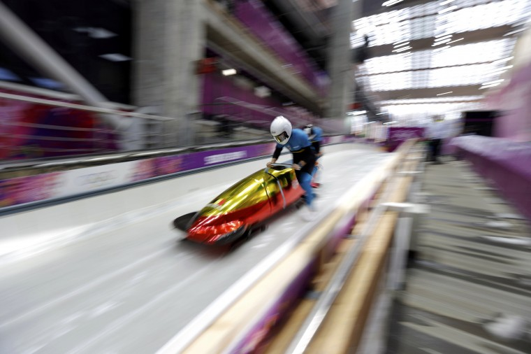Belgium's pilot Elfje Willemsen starts a two-women bobsleigh training session at the Sanki Sliding Center in Rosa Khutor, during the Sochi 2014 Winter Olympics February 15, 2014. REUTERS/Murad Sezer