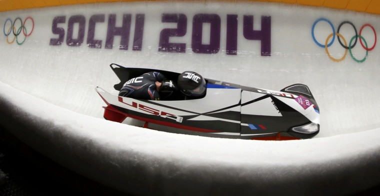 Pilot Steven Holcomb (front) and Steven Langton of the U.S. speed down the track in the men's two-man bobsleigh competition at the 2014 Sochi Winter Olympics February 16, 2014. (Fabrizio Bensch/Reuters)