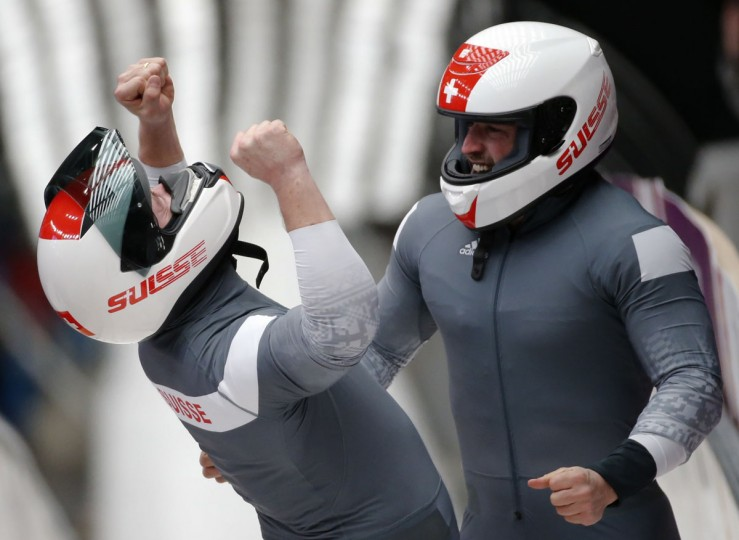 Switzerland's pilot Beat Hefti (left) and Alex Baumann celebrate a second-place finish in the two-man bobsled event at the 2014 Sochi Winter Olympics, at the Sanki Sliding Center in Rosa Khutor February 17, 2014. (Fabrizio Bensch/Reuters)