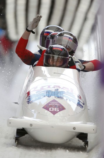 Russia's pilot Alexander Kasjanov (front), Ilvir Huzin, Maxim Belugin and Aleksei Pushkarev react during a heat of the four-man bobsleigh event. (REUTERS/Murad Sezer)