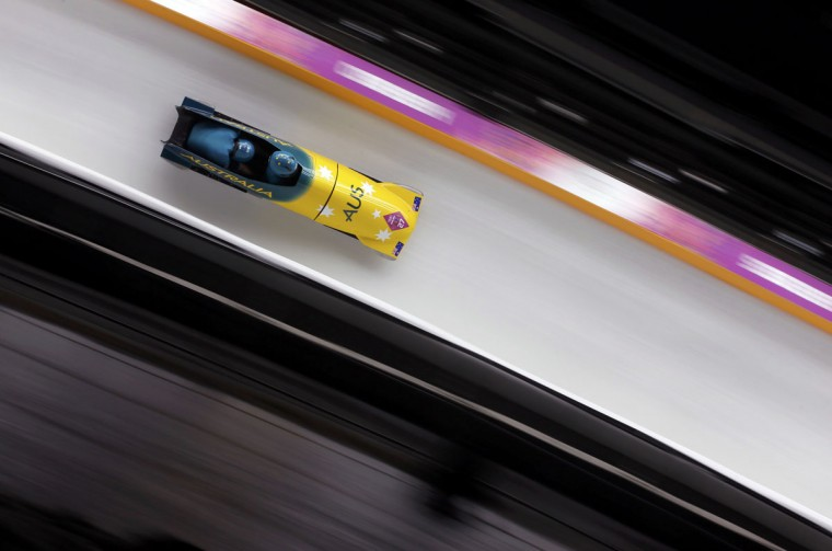 Australia's pilot Heath Spence (front) and Duncan Harvey speed down the track during the men's two-man bobsleigh competition at the 2014 Sochi Winter Olympics February 16, 2014. (Arnd Wiegmann/Reuters)