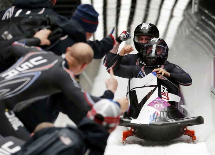 Pilot Steven Holcomb (front) and Steven Langton of the U.S. finish the final run of the men's two-man bobsled competition at the 2014 Sochi Winter Olympics February 17, 2014. The pair finished third, winning the U.S. its first bobsled medal in over 60 years. (Fabrizio Bensch/Reuters)
