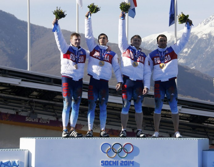 From left, Russia gold medalists Alexander Zubkov, Alexey Negodaylo, Dmitry Trunenkov and Alexey Voevoda pose on the podium during the medal ceremony for the four-man bobsleigh event. (REUTERS/Fabrizio Bensch)