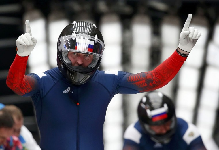 Russia's pilot Alexander Zubkov gestures after he and Alexey Voevoda compete in the men's two-man bobsleigh competition at the 2014 Sochi Winter Olympics February 16, 2014. (Murad Sezer/Reuters)