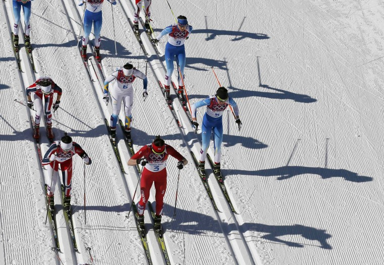 Competitors ski in the women's cross-country skiathlon event at the 2014 Sochi Winter Olympics February 8, 2014. (REUTERS/Stefan Wermuth)