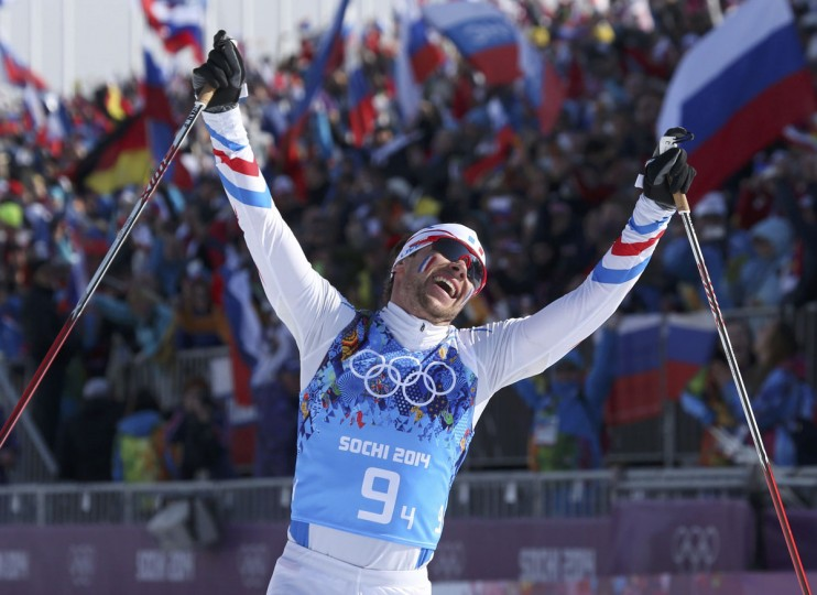 France's Ivan Perrillat Boiteux celebrates as he crosses the finish line in the men's cross-country 4 x 10km relay event at the 2014 Sochi Winter Olympics February 16, 2014. (Sergei Karpukhin/Reuters)