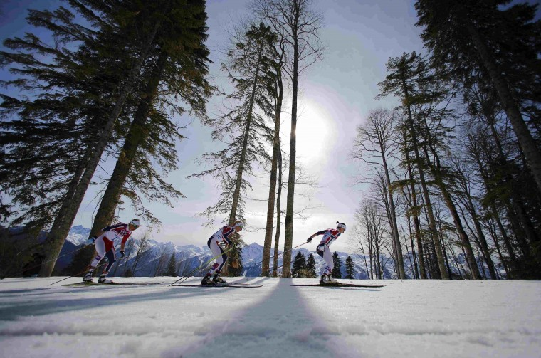 Norway's Therese Johaug, Kristin Stoermer Steira and Marit Bjoergen (R-L) lead during the women's cross-country 30 km mass start free event at the Sochi 2014 Winter Olympic Games February 22, 2014. (REUTERS/Carlos Barria)
