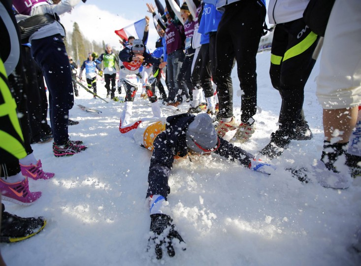 France's Robin Duvillard slides in the snow as he celebrates after the flower ceremony for the men's cross-country 4 x 10km relay event at the 2014 Sochi Winter Olympics February 16, 2014. (Carlos Barria/Reuters)