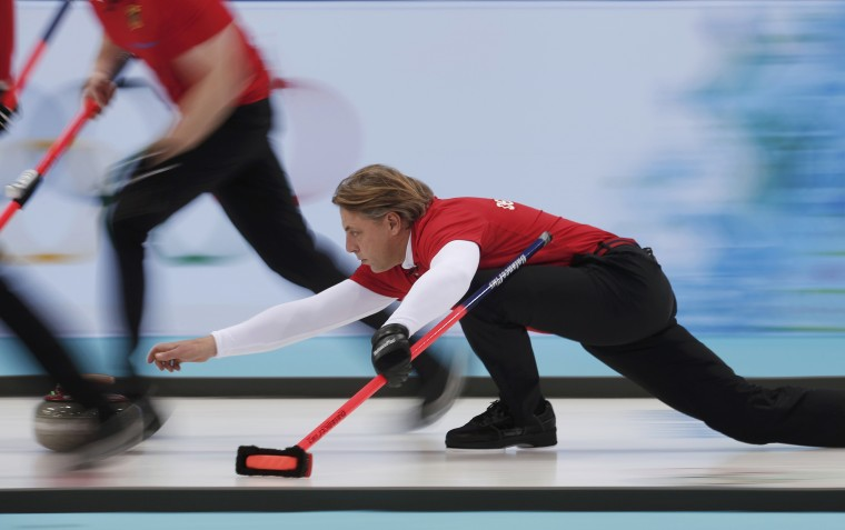 Germany's skip John Jahr delivers a stone during the team's men's curling round robin game against Canada at the 2014 Sochi Olympics, February 10, 2014. (Mark Blinch/Reuters)