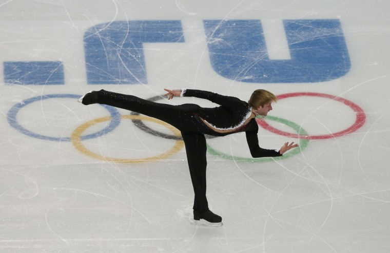 Evgeny Plyushchenko of Russia competes during the Team Men's Short Program at the Sochi 2014 Winter Olympics. (REUTERS/David Gray)