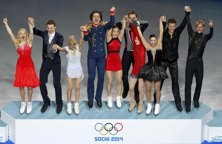 The Russian figure skating team steps onto the podium after winning a gold medal in the team skating event at the Sochi 2014 Winter Olympics, February 9, 2014. From left to right: Ekaterina Bobrova and Dmitri Soloviev, Tatiana Volosozhar and Maxim Trankov, Ksenia Stolbova and Fyodor Klimov, Yulia Lipnitskaya, Elena Ilinykh and Nikita Katsalapov, Evgeny Plyushchenko. (Brian Snyder/Reuters)