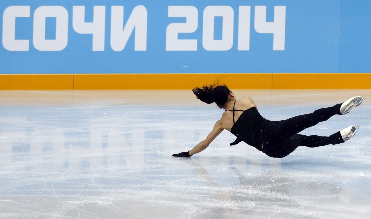 Japan's Akiko Suzuki falls during a figure skating training session in preparation for the 2014 Sochi Winter Olympics, in Sochi February 7, 2014. REUTERS/Alexander Demianchuk