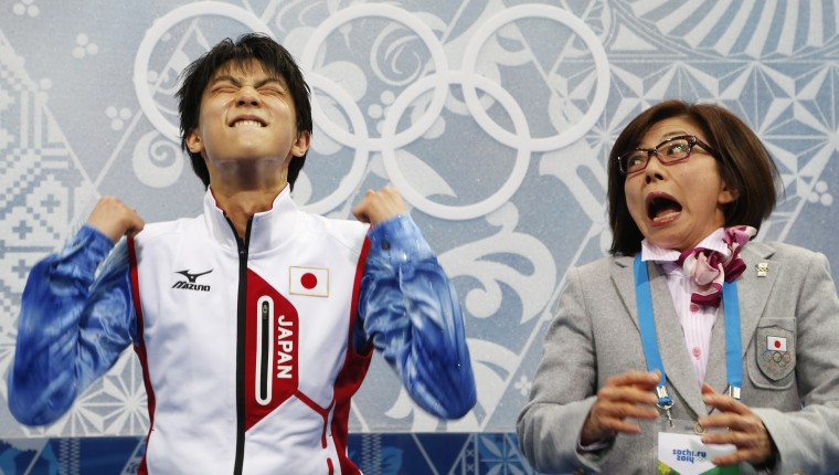 "Japan's Yuzuru Hanyu and figure skating coach Yoshiko Kobayashi react in the ""kiss and cry"" area during the figure skating men's short program at the Sochi 2014 Winter Olympics February 13, 2014. REUTERS/Lucy Nicholson"